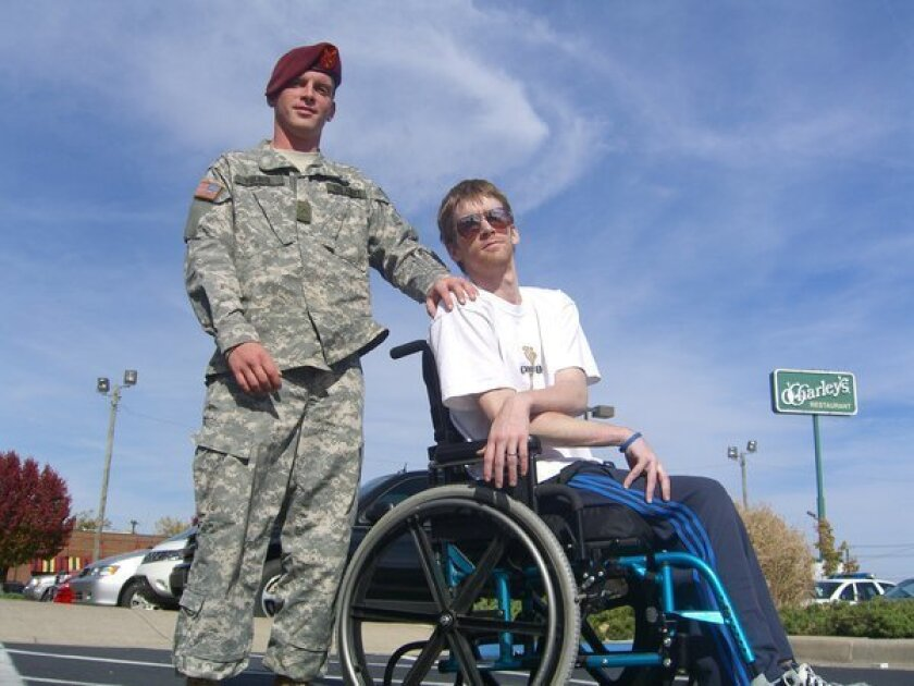 Tomas Young, shown with his brother Nathan in 2007, has decided he will stop taking food, water and medicine until finally death takes him, and he is giving a politically charged farewell before he goes.