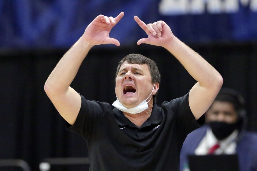 FILE - In this March 12, 2021, file photo, Abilene Christian head coach Joe Golding reacts during the second half of an NCAA college basketball game against Lamar in the semifinals of the Southland Conference tournament in Katy, Texas. Golding has been named the new coach at UTEP after a decade at Abilene Christian that included an upset victory for the Wildcats in the first round of this season's NCAA Tournament. (AP Photo/Michael Wyke, File)