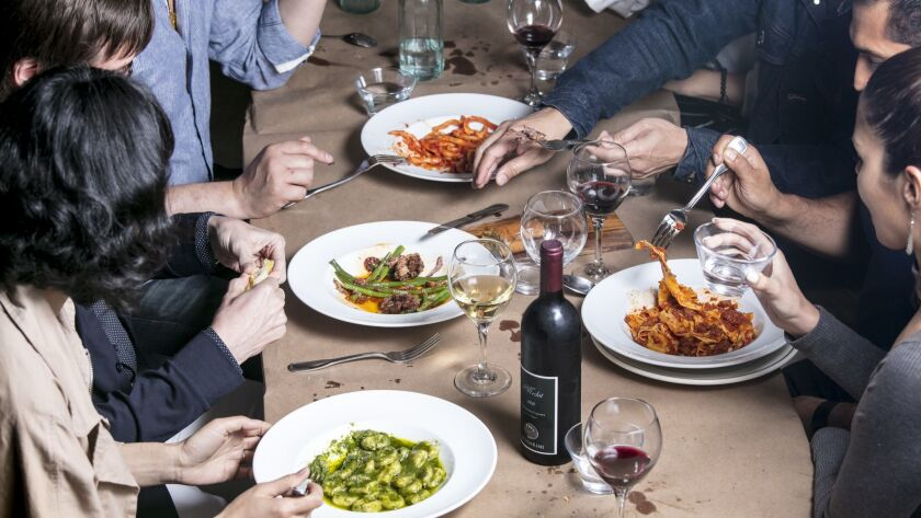 LOS ANGELES, CALIFORNIA - June 4, 2019: Guests enjoy plates of: pici all'aglione (a hand-rolled pas