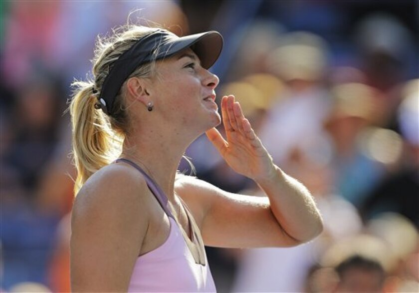Maria Sharapova, of Russia, reacts after winning her match against Mallory Burdette in the third round of play at the 2012 US Open tennis tournament,  Friday, Aug. 31, 2012, in New York. Sharapova won the match. (AP Photo/Mike Groll)