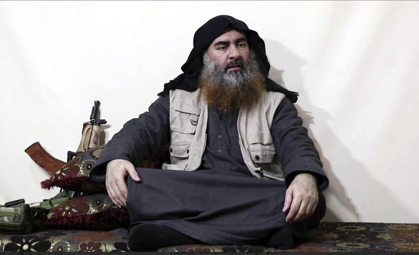FILE - This file image made from video posted on a militant website April 29, 2019, purports to show the leader of the Islamic State group, Abu Bakr al-Baghdadi being interviewed by his group's Al-Furqan media outlet. In his last months on the run, al-Baghdadi was agitated, fearful of traitors, sometimes disguised as a shepherd, sometimes hiding underground, always dependent on a shrinking circle of confidants. (Al-Furqan media via AP, File)