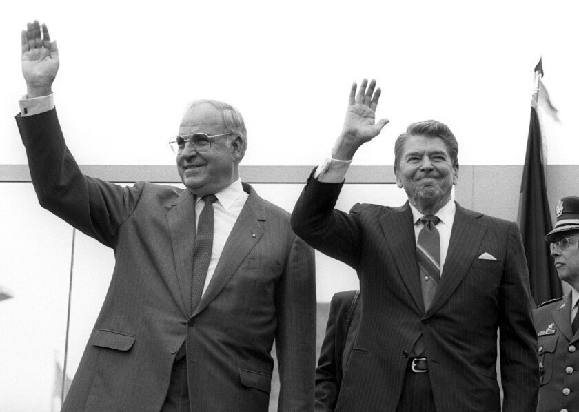 President Reagan, right, and former German chancellor Helmut Kohl visit the Berlin Wall in West Berlin, Germany, on the occasion of Berlin's 750th anniversary on June 12, 1987.