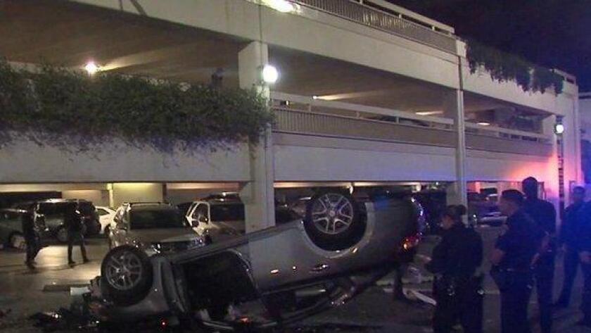 Car falls at Fashion Valley (/ @41ActionNews)