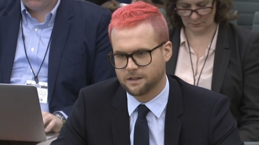 In this image taken from video in London on Tuesday, Chris Wylie gives evidence at a House of Commons inquiry into fake news.