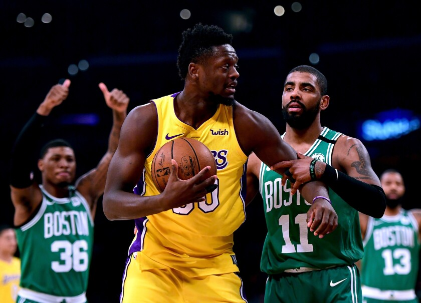LOS ANGELES, CA - JANUARY 23: Julius Randle #30 of the Los Angeles Lakers reacts as he is tied up by Kyrie Irving #11 of the Boston Celtics for a jump ball during the first half at Staples Center on January 23, 2018 in Los Angeles, California.