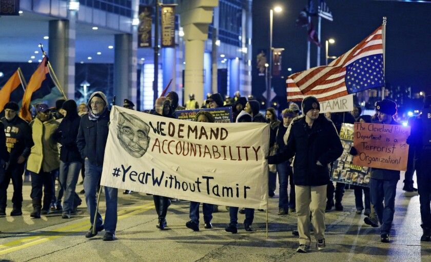 People protest a grand jury's decision not to indict two white Cleveland police officers in the fatal shooting of Tamir Rice, a black 12-year-old boy who was playing with a pellet gun, in Cleveland on Dec. 29.