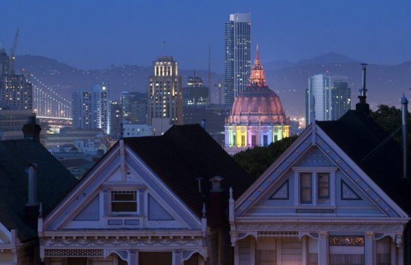 San Francisco's Civic Center is lit up Saturday on the eve of the city's big gay pride parade.