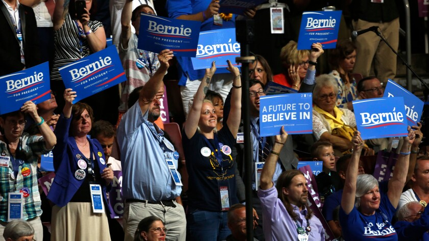 Bernie Sanders supporters cheer him on during first night of the Democratic National Convention.
