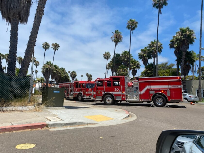 San Diego Fire-Rescue crews respond to a two-alarm fire in an apartment complex on Playa del Sur in La Jolla July 20.