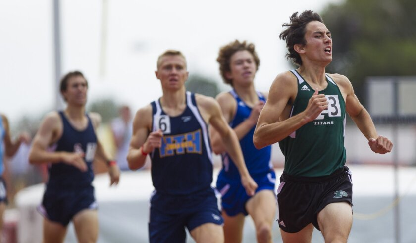 Poway junior Jarett Chinn crosses the finish line to win the section 800 meters title in a blistering time of 1 minute, 53.78 seconds.