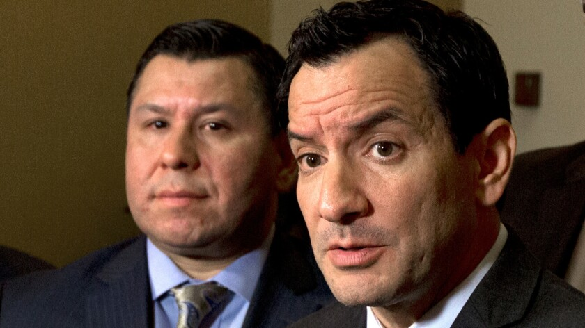 Assembly Speaker Anthony Rendon, right, speaks to reporters about climate legislation that's part of a package from Assemblyman Eduardo Garcia, left, and Sen. Fran Pavley.