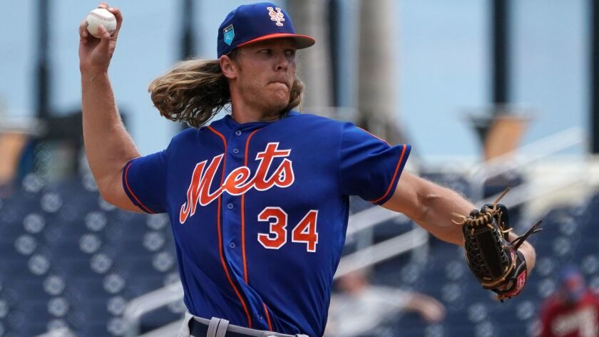 Mets pitcher Noah Syndergaard (34) delivers a pitch in the first inning against the Houston Astros at The Ballpark of the Palm Beaches on Feb. 26, 2018.