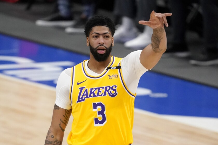 Los Angeles Lakers forward Anthony Davis gestures during the first half of the team's NBA basketball game against the Dallas Mavericks in Dallas, Thursday, April 22, 2021. (AP Photo/Tony Gutierrez)