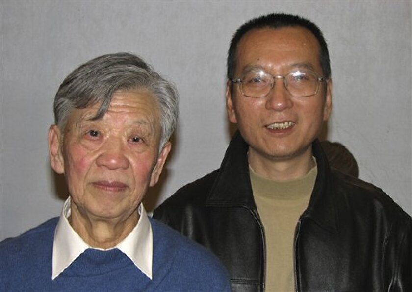 "In this photo taken in November, 2007 and released by Liu Xiaobo's friend Friday, Oct. 8, 2010, Liu, right, poses with legal scholar Zhang Sizhi during a gathering in Beijing. Imprisoned Chinese dissident Liu Xiaobo won the 2010 Nobel Peace Prize on Friday, Oct. 8, 2010, for using non-violence to demand fundamental human rights in his homeland. The award ignited a furious response from China, which accused the Norwegian Nobel Committee of violating its own principles by honoring ""a criminal."" (AP Photo)"