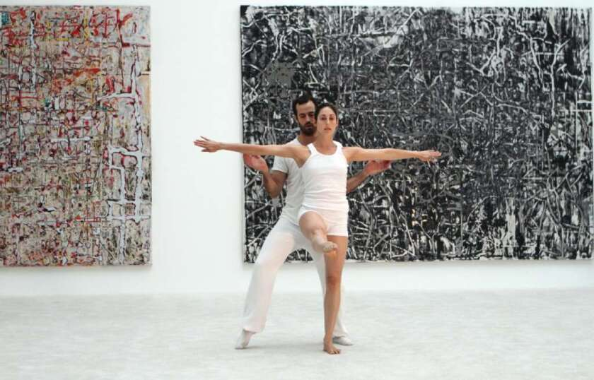 LA Dance Project's Benjamin Millepied performs at MOCA in July with dancer Amanda Wells in front of paintings by Mark Bradford.