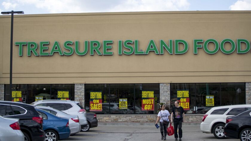 Ten former Treasure Island workers have filed a lawsuit against the grocer alleging they weren't given sufficient layoff notice under state and federal law.