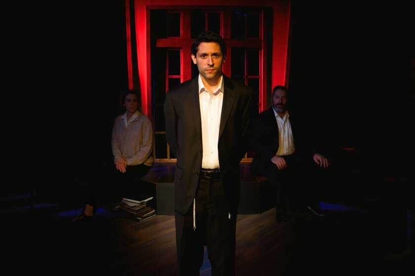 "Craig De Lorenzo (center) portrays a Jewish artist driven to paint Christian imagery, in North Coast Repertory Theatre's ""My Name is Asher Lev."""