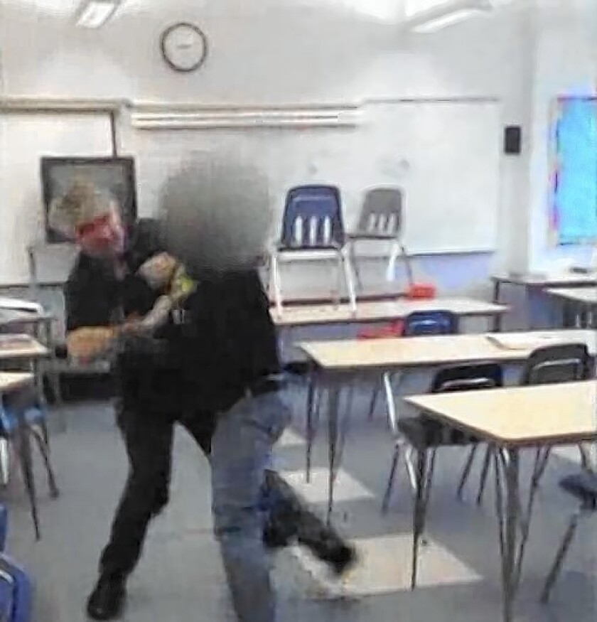 A cellphone video shows Santa Monica High School teacher Mark Black grappling with a student in his classroom. Black, who was placed on administrative leave after the incident, has been reinstated.