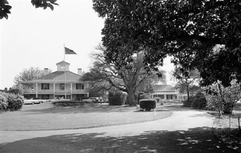 FILE - This April 2, 1963 file photo shows the Augusta National Club house in Augusta, Ga. As host of the Masters golf tournament, the club takes pride in preserving traditions, even to the point of anachronism: pimento cheese sandwiches selling for $1.50 at the snack venues, caddies in white overalls, nostalgic music and minimal ads on the tournament telecasts. And then there's that other throwback - exclusion of women from the club's elite, CEO-studded membership. It's retro, but not necessarily in a way that inspires warm-and-fuzzy nostalgia. (AP Photo/Perry Aycock)