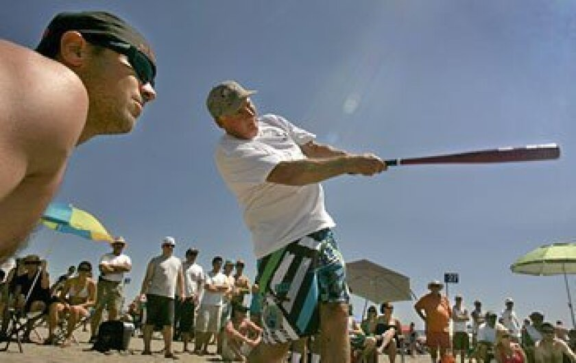 Mike Ham (left) of La Mesa and Chuck Cromar of Pacific Beach are teammates in the tournament.  (Howard Lipin / Union-Tribune)