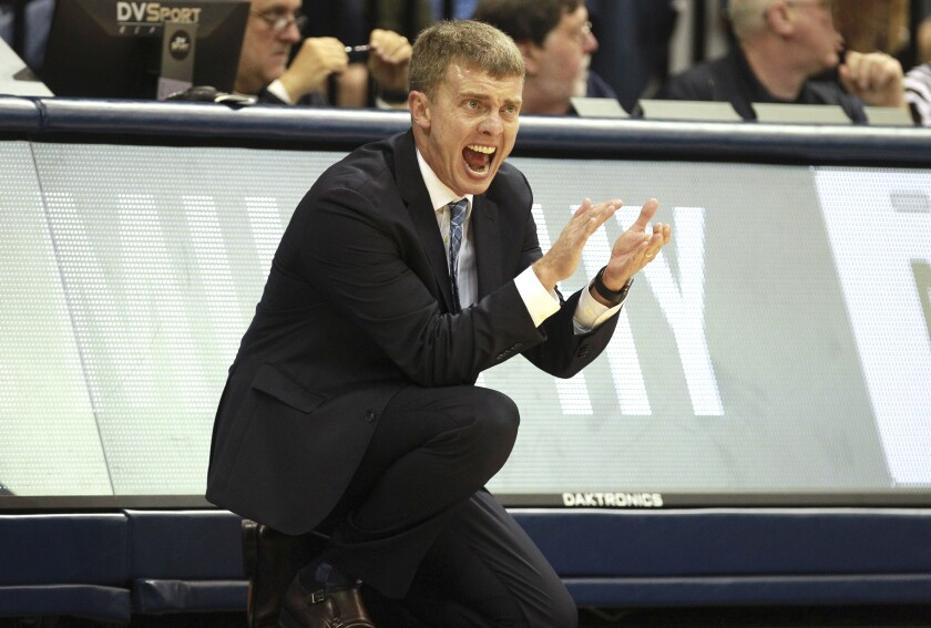 USD coach Sam Scholl calls out to his players as they play Gonzaga in January.