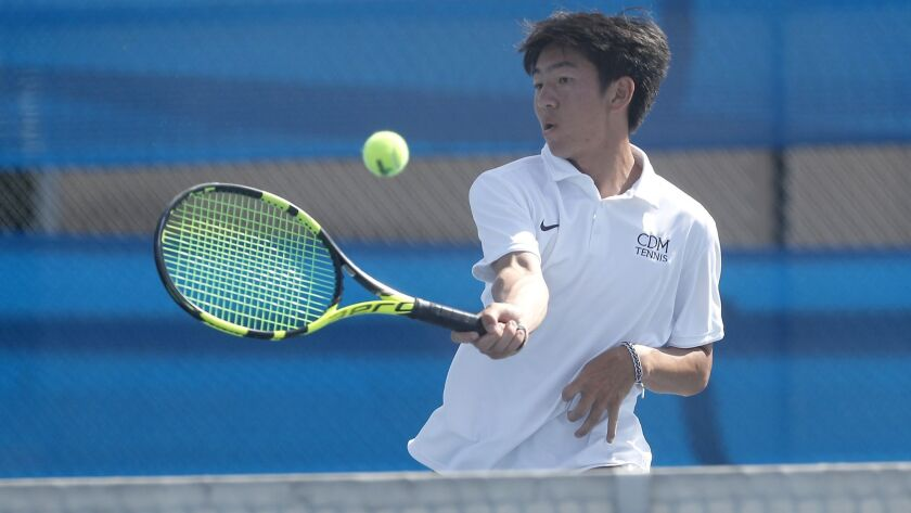 Corona del Mar High's Kyle Pham scores at the net against Fountain Valley in a No. 1 singles set dur