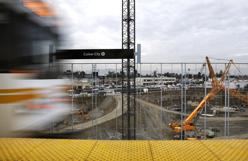 A Metro Expo Line train passes by construction in Culver City on Jan. 3, 2017.