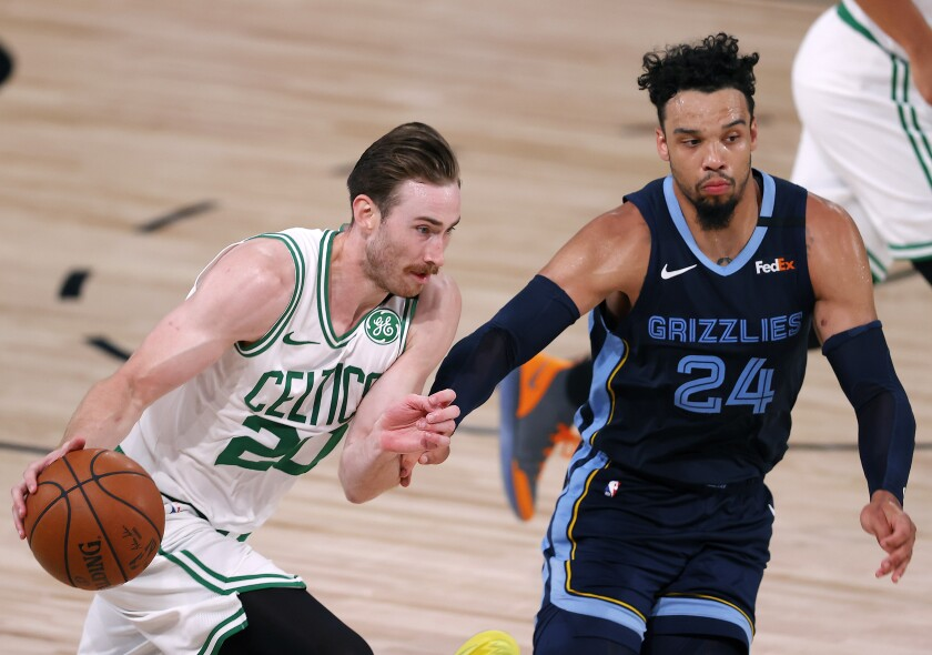 The Boston Celtics' Gordon Hayward drives on the Memphis Grizzlies' Dillon Brooks.