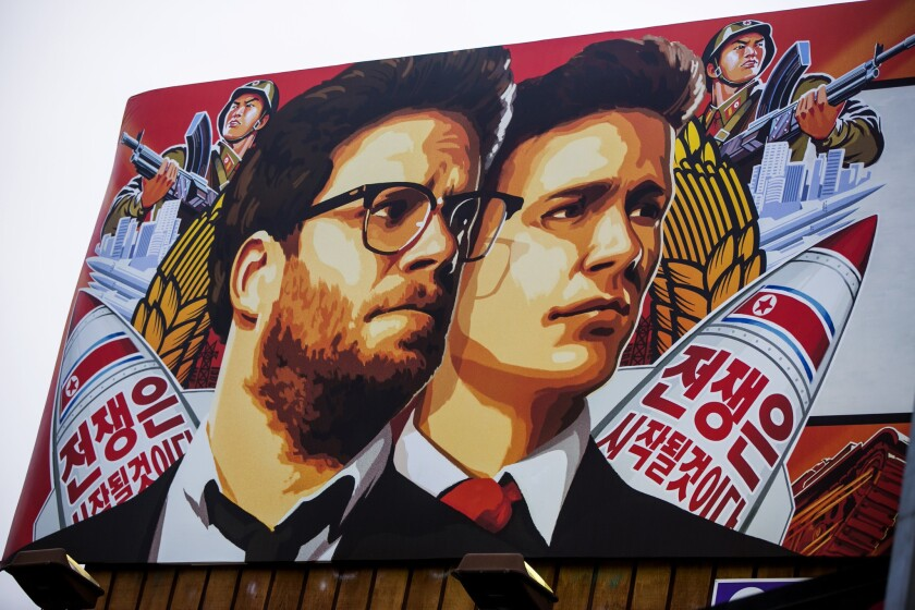 """A banner for """"The Interview"""" is posted outside Arclight Cinemas in Hollywood on Dec. 17."""