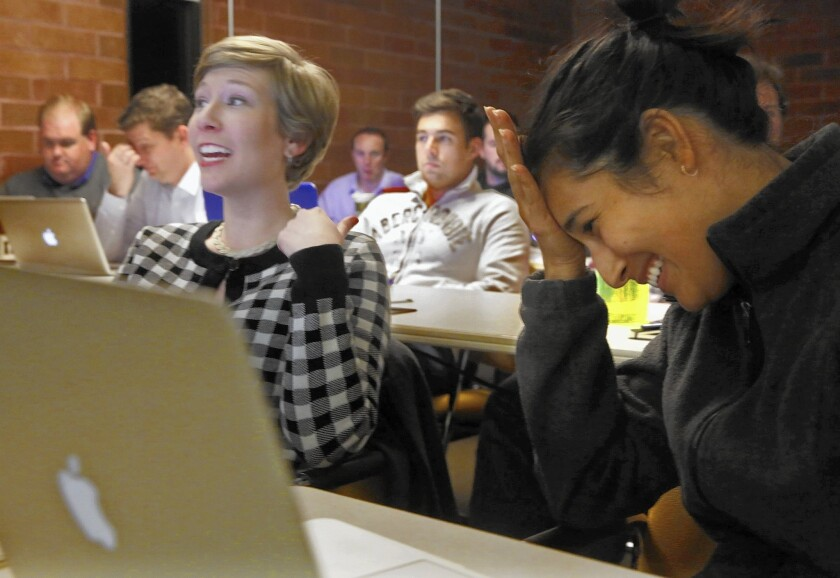 Raihane Dalvi, right, reacts as her fellow law clinic colleague Amanda Kelly makes a point about a legal issue.