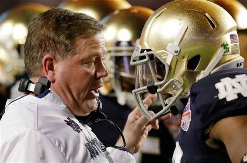 Notre Dame head coach Brian Kelly talks to Robby Toma during the first half of the BCS National Championship college football game against Alabama Monday, Jan. 7, 2013, in Miami. (AP Photo/Chris O'Meara)
