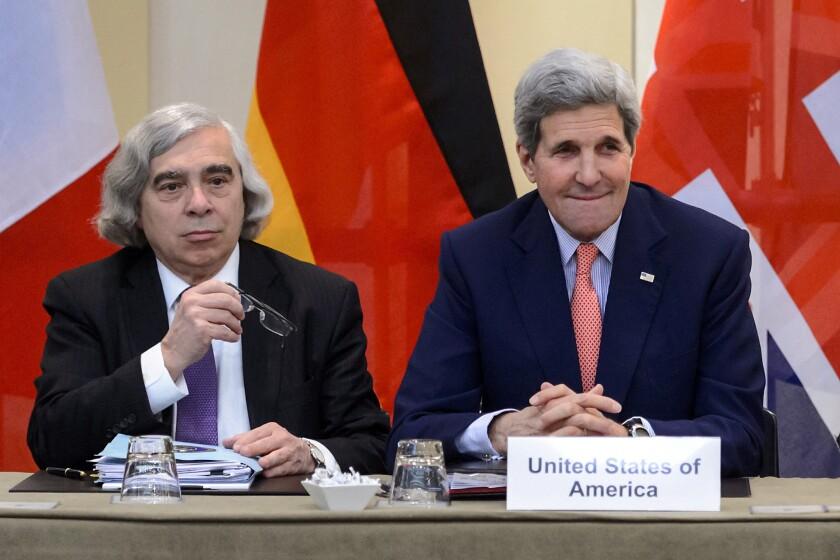 U.S. Secretary of Energy Ernest Moniz, left, and Secretary of State John F. Kerry attend Iran nuclear talks in Lausanne, Switzerland, on Saturday.