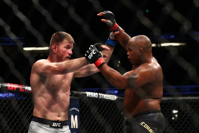 Daniel Cormier throws a punch at Stipe Miocic in the second round during their UFC Heavyweight Title Bout at UFC 241 at Honda Center on Saturday.