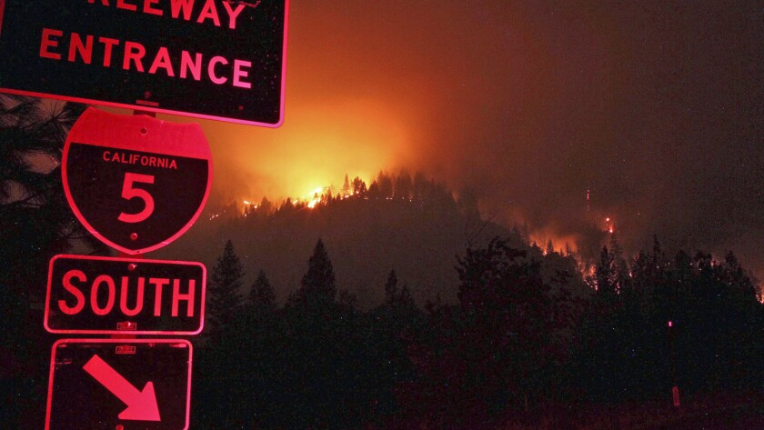 Wildfires burn Friday on the ridgeline east of I-5 just south of the Gibson Road exit near Shasta-Trinity National Forest.