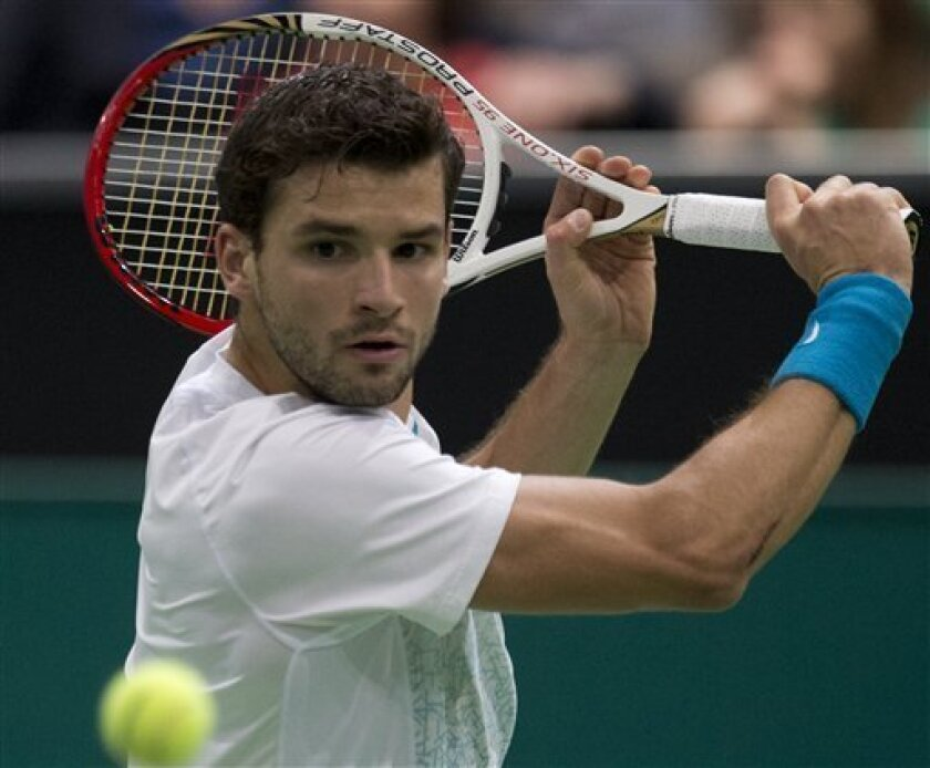 Grigor Dimitrov of Bulgaria returns a shot against Argentina's Juan Martin del Potro during the semi final match at the ABN AMRO world tennis tournament at Ahoy Arena in Rotterdam, Netherlands, Saturday Feb. 16, 2013. (AP Photo/Peter Dejong)