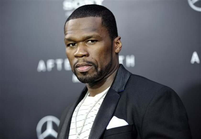 "FILE - In this May 29, 2013, rapper Curtis ""50 Cent"" Jackson attends the ""After Earth"" premiere at the Ziegfeld Theatre, in New York. Jackson has been charged with attacking his ex-girlfriend and trashing her Los Angeles condo last month. City Attorney Mike Feuer said Wednesday, July 3, 2013, the 3"