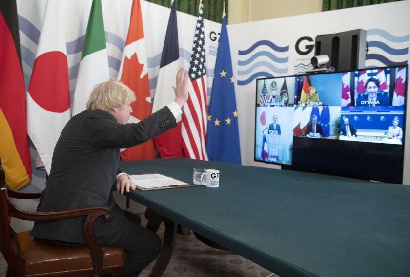 British Prime Minister Boris Johnson waves to world leaders.