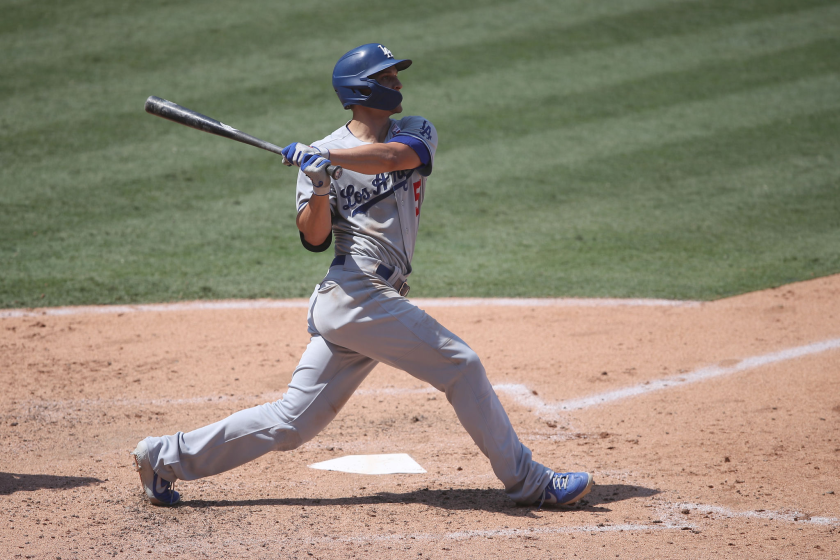 Dodger shortstop Corey Seager hits a three-run home run during the fourth inning against the Angels.