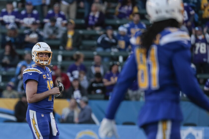 Chargers quarterback Philip Rivers walks off the field after throwing his third interception against the Vikings on Sunday.