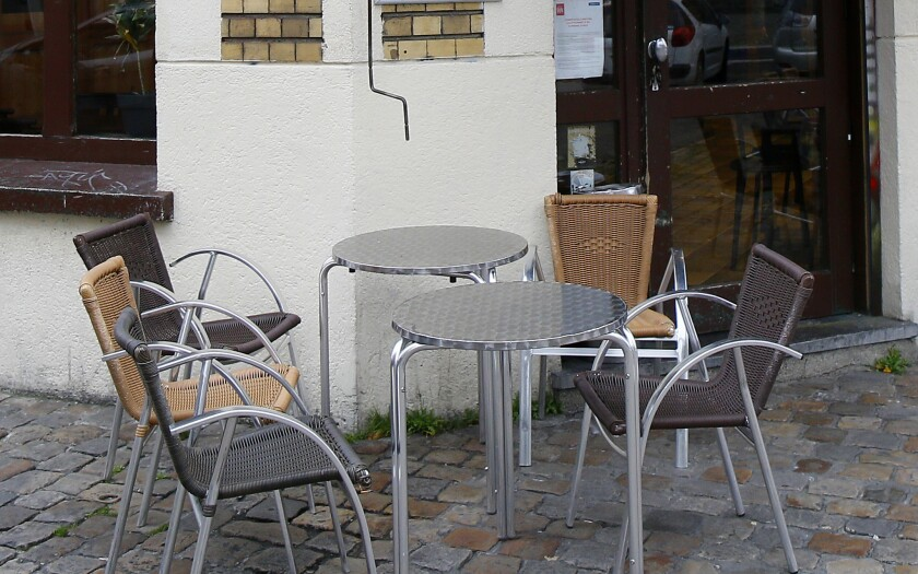 Empty cafe tables in Lille, France