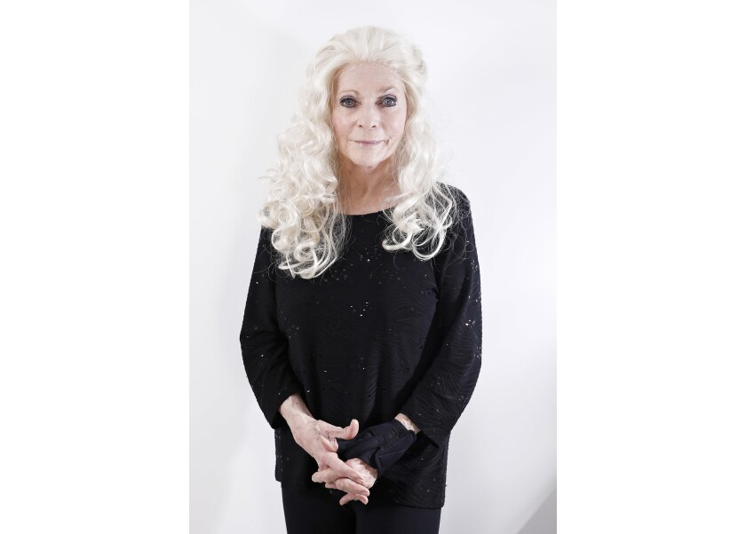 FILE - In this Nov. 14, 2017 photo, Judy Collins poses for a portrait in New York. When she was 24, folk singer Judy Collins went onstage in New York City to record her first live concert and maybe inspire social change. Last month, she returned to the same stage to do the whole thing again. Collins recreated her legendary concert hall debut at The Town Hall from March 21, 1964, recorded on the cusp of Freedom Summer. (Photo by Brian Ach/Invision/AP, File)
