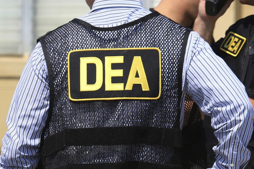 FILE - This June 13, 2016 file photo shows Drug Enforcement Administration agents in Florida. Federal investigators took the unusual step of wiretapping a retired supervisor in the U.S. Drug Enforcement Administration's Miami office for at least three months in 2019 as part of an inquiry into whether sensitive case information was leaked to attorneys for suspected drug traffickers in Colombia, current and former law enforcement officials told The Associated Press. (Joe Burbank/Orlando Sentinel via AP, File)