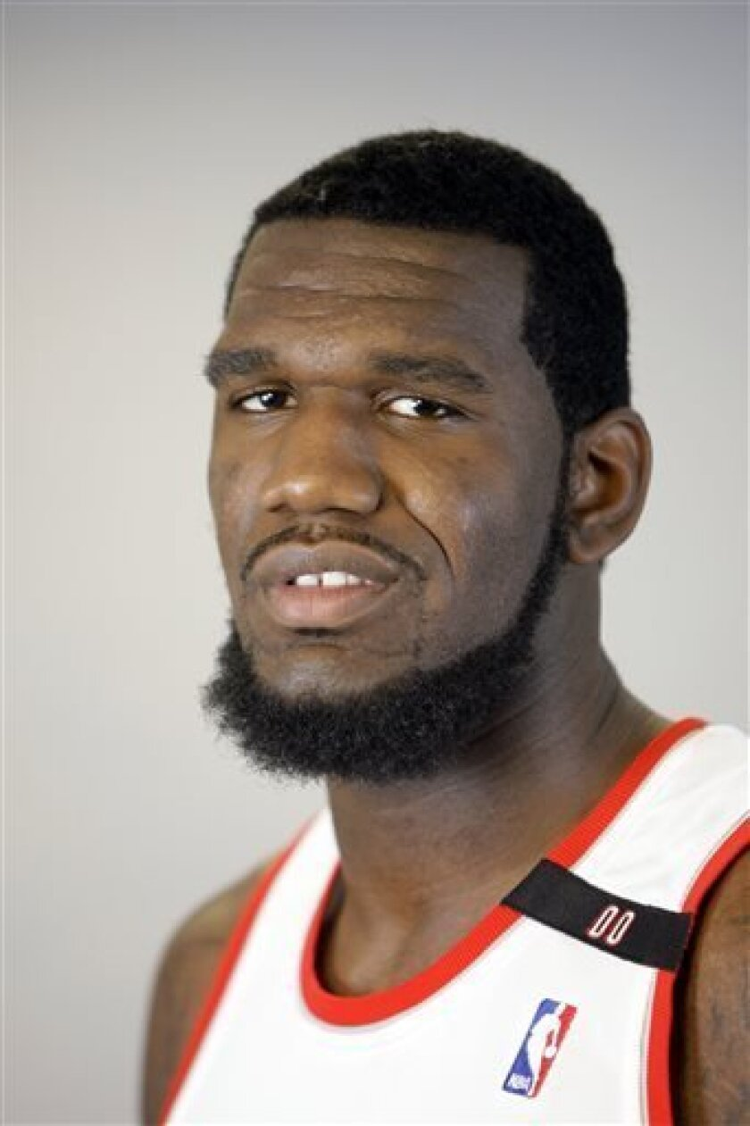 File-This photo taken Sept. 29, 2008 shows former Portland Trail Blazers' Greg Oden poses during media day for the NBA basketball team at the Rose Garden, in Portland, Ore. A person familiar with the situation says Oden has told the Miami Heat that he will accept their contract offer. Oden has informed the Heat of his decision and is expected to formally sign in the coming days, the person told The Associated Press on condition of anonymity Friday, Aug.2, 2013 because no contract has been sign
