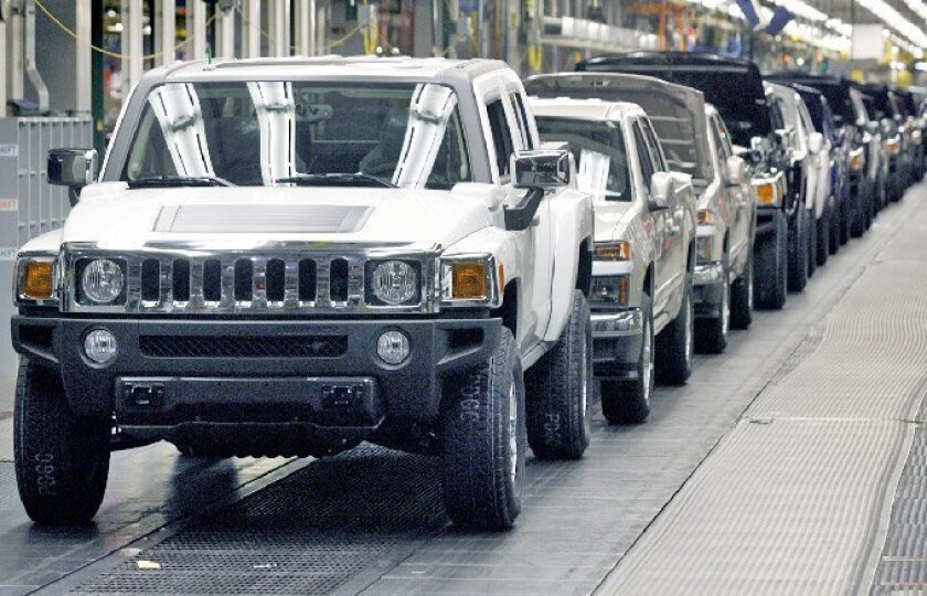A line of Hummer H3T pickups stretched through General Motors' assembly  plant in Shreveport, La., last month. The brand's headquarters is  expected to remain in the Detroit area.  (General Motors)