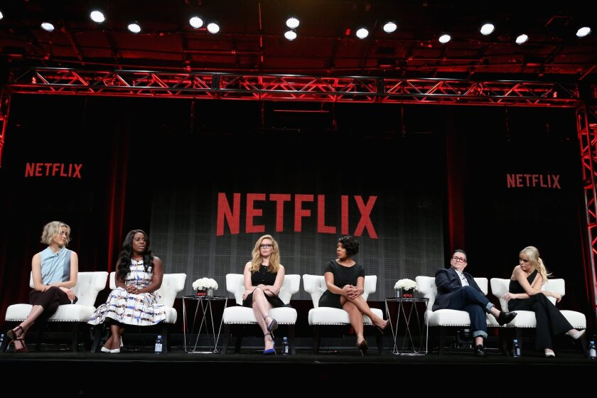 "Actors Taylor Schilling, from left, Uzo Aduba, Natasha Lyonne, Selenis Leyva, Lea DeLaria and Taryn Manning speak during the ""Orange Is the New Black"" panel discussion in the Netflix portion of the 2015 Summer TCA Tour at the Beverly Hilton Hotel on July 28, 2015."