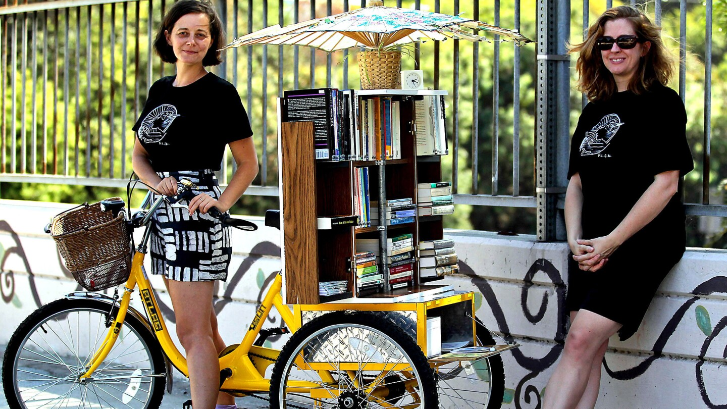 The Feminist Library on Wheels is the creation of Jenn Witte, left, and Dawn Finley. They plan to take their mobile lending library of feminist texts all around Los Angeles.