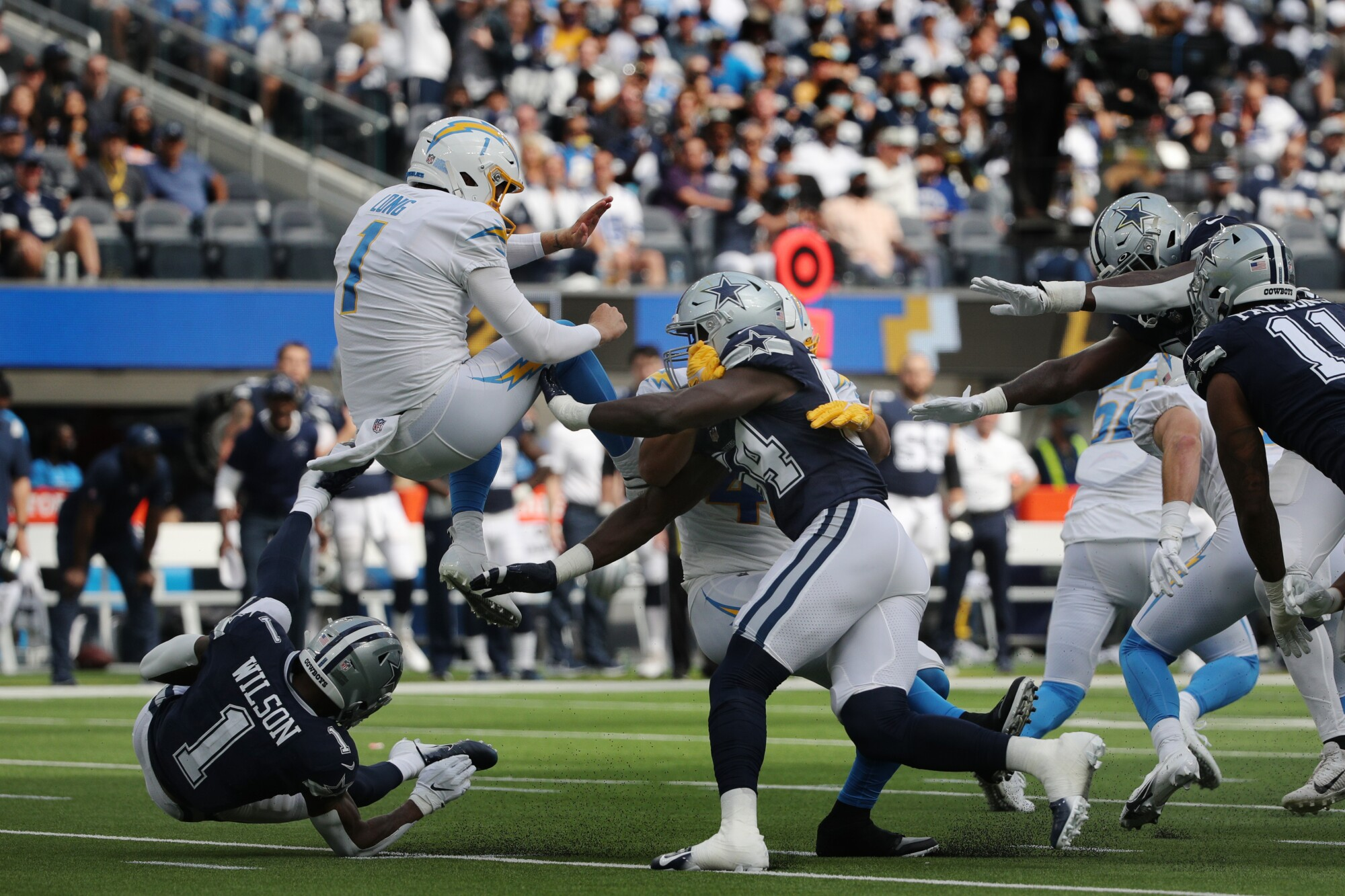 Dallas Cowboys defensive end Azur Kamara is penalized for roughing Chargers punter Ty Long.