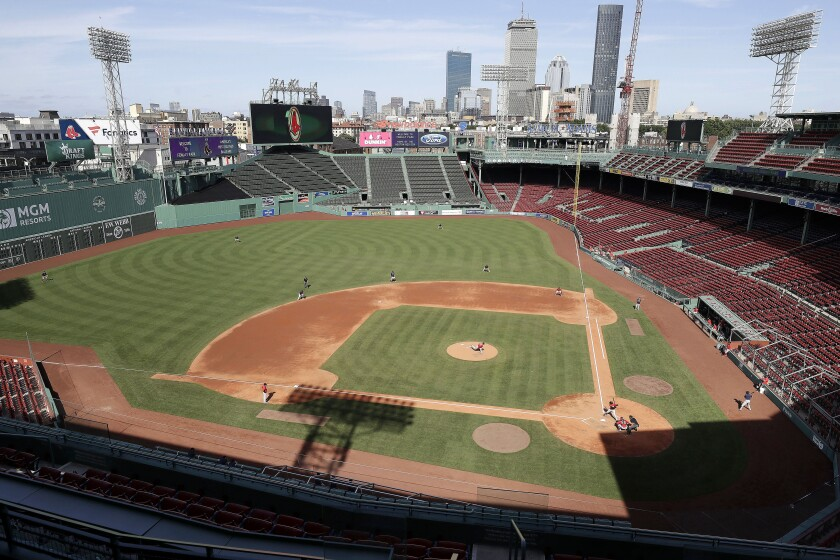 Boston Red Sox baseball players practice at Fenway Park, Thursday, July 16, 2020, in Boston. (AP Photo/Steven Senne)