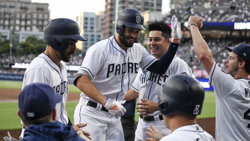 Eric Hosmer is congratulated after hitting a two-run home run against the Chicago Cubs at on July 14 at Petco Park.