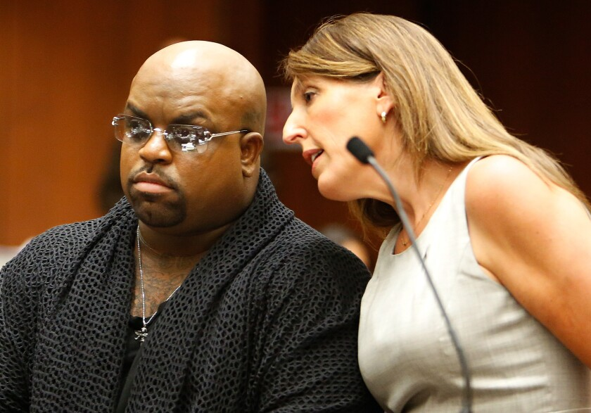 Cee Lo Green, a.k.a. Thomas DeCarlo Callaway, left, with attorney Blair Berk, in a Los Angeles courtroom last year.